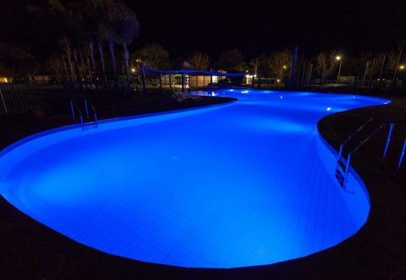 Luxury Swimming Pool Glowing In Blue Light At Night