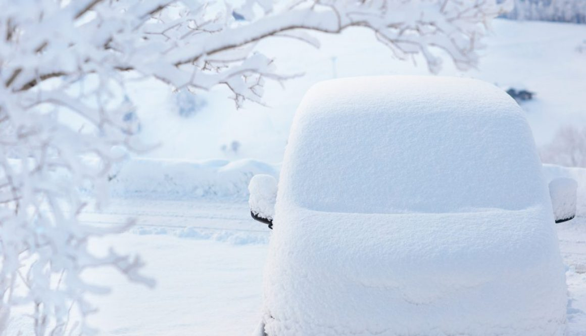 Car Covered With Snow After Winter Storm. Vehicle Parked Snowy T